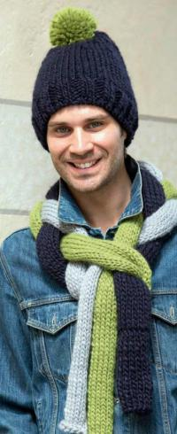 Как связать для мужчин шарф из крупных цветных кос и шапочка с помпоном