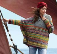 Как связать спицами широкий пуловер-пончо с цветным узором