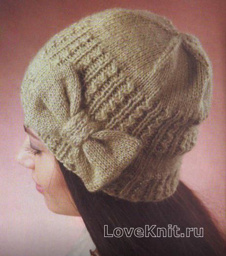 Как связать спицами узорчатая шапка с бантом