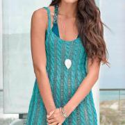 Как связать спицами платье-майка с вертикальным узором из кос