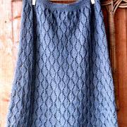 Как связать спицами длинная юбка с ромбами